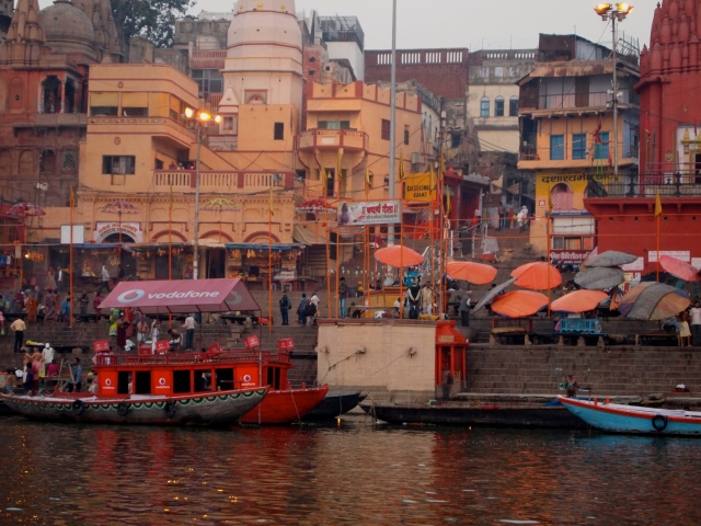Banks of the Ganges with Orange Umbrellas
